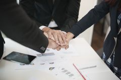 Group Asian Young businessmen join hands for working the job success, Hand coordination, symbolizing the hands to unity and. Teamwork, meeting, helps , business stock photos