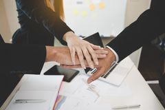 Group Asian Young businessmen join hands for working the job success, Hand coordination, symbolizing the hands to unity and. Teamwork, meeting, helps , business stock photo