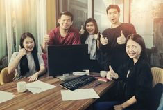 Group of asian younger freelancing team work happiness emotion i. N home office stock photo