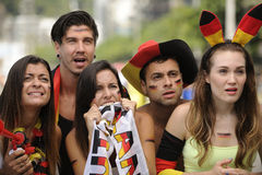 Group of astonish German sport soccer fans. Watching the game Royalty Free Stock Images