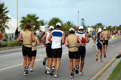 Group of athletes. A group of caucasian athletes running together on the road participating in a triathlon Royalty Free Stock Photos