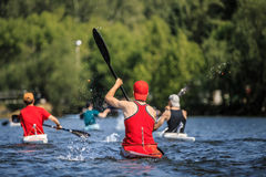 Group of athletes canoeists boating on  lake Stock Images