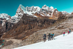Group of Athletes of different Age crossing Glacier in high Mountains Royalty Free Stock Photo