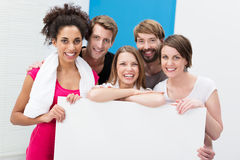 Group of athletes holding a blank sign Stock Photo