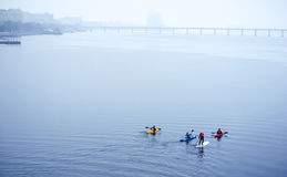 Group of athletes kayaking on the river Royalty Free Stock Images