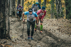 Group of athletes runners uphill side in woods. Yalta, Russia - November 2, 2015: group of athletes runners uphill side in woods during Mountain marathon Royalty Free Stock Image