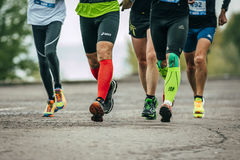 Group of athletes running along the embankment Stock Photography