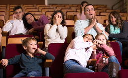 Group attending movie night for horror Stock Photo