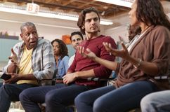 Free Group Attending Neighborhood Meeting In Community Center Royalty Free Stock Image - 153623356