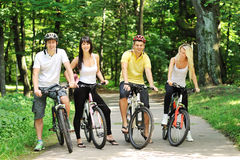 Group of attractive happy people on bicycles in the countryside Royalty Free Stock Image