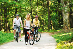 Group of attractive happy people on bicycles in the countryside Stock Images