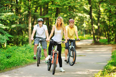 Group of attractive happy people on bicycles in the countryside Royalty Free Stock Photo