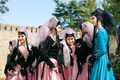 Group of attractive young girls in beautiful dresses meeting at event of city festival Stock Photo