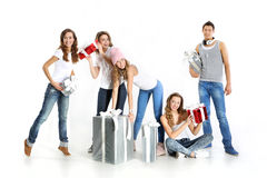 Group of attractive young people with gifts Royalty Free Stock Photo