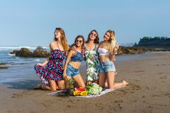 group of attractive young women with various fruits spending time stock photo