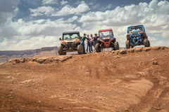 Group of ATV riders at the summit of  Hurrah Pass. MOAB, UT, USA - MAY 7, 2017: Group of ATV riders enjoys a break on a summit of the Hurrah Pass on the popular Royalty Free Stock Images
