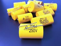 Group of audiophile metal-film axial capacitors different sizes. stock photography