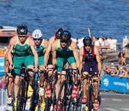 Group of Australien triathlon competitors cycling uphill Stock Images