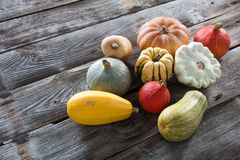 Group of autumn colorful organic vegetables over genuine old wood Stock Images