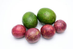 Group of avocados and passion fruit isolated on a white. Group of avocados and passion fruit isolated on a white background Stock Photo