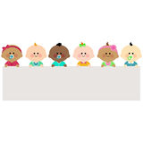 Babies holding horizontal blank banner. A happy multicultural group of babies holding a blank horizontal banner Stock Image