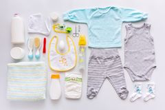 Group of baby boy clothes and equipment. Stock Photos