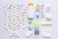 Group of baby clothes and equipment. Stock Photos
