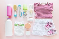 Group of baby girl clothes and equipment. stock image