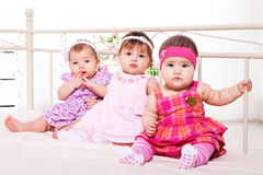 Baby girls in lovely dresses Royalty Free Stock Photography