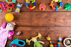 Group of baby toys on wooden background with copy space. top vie. Group of baby toys on brown wooden background with copy space. top view stock image