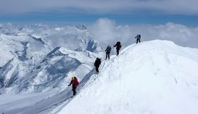Group of backcountry skiers on a ski mountaineering tour in the Austrian Alps heading to the summit of Grossvenediger Stock Photography