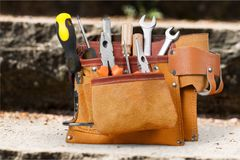 Tool belt with tools close-up view royalty free stock images