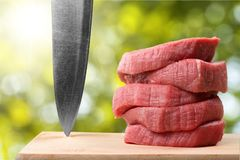 Raw Meat slices and knife on cutting board. Group background market shop fresh beef meat Royalty Free Stock Images