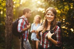 Group of backpacking hikers going for forest trekking. Group of backpacking hikers friends going for forest trekking stock photos