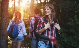 Group of backpacking hikers going for forest trekking. Group of backpacking hikers friends going for forest trekking royalty free stock image