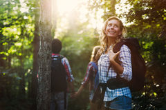 Group of backpacking hikers going for forest trekking. Group of backpacking hikers friends going for forest trekking Royalty Free Stock Images