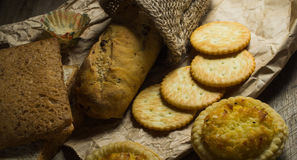 Group of baked bread. Assortment of baked bread on wooden board Royalty Free Stock Image