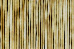 Group of baked italian bread sticks background on black background surface stock photo