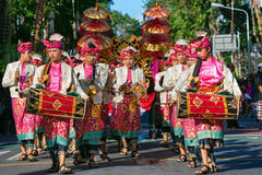 Group of Balinese men in traditional costumes play gamelan music Stock Images