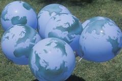 A group of balloons designed to look like globes Stock Photos