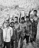 A group of farmers standing around an agricultural field. A group of Bangladeshi farmers standing together and showing victory sign by fingers stock images