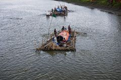 People travelling on the boat in the river unique editorial image. A group of Bangladeshi people are travelling on a traditional boat in the river unique royalty free stock photography