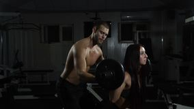 Group with barbell weight training equipment on sport gym. Man and women trains stock video footage