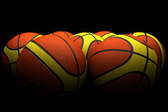 Group of basketballs in dim light Stock Photos