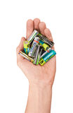 Group of batteries in hand Stock Images