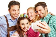 Group in bavaria taking selfie Royalty Free Stock Photos