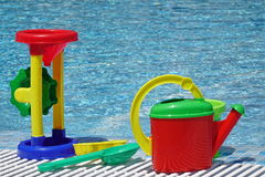 Group Of Beach Plastic Colorful Child Toys At The Poolside Royalty Free Stock Image
