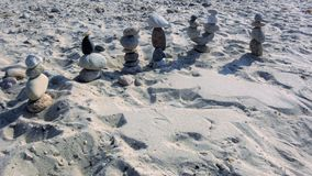 Group of beach stone figures in Sandwich MA March off to a distant location. Found on beach with no clear ownership or re Royalty Free Stock Photography