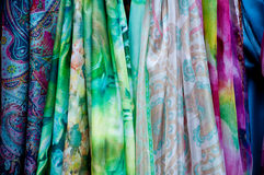 Group of beautiful colored scarves in cotton and wool Royalty Free Stock Photo
