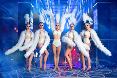 Group of beautiful female dancers in white carnival costumes stock photo